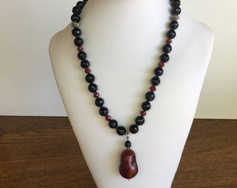 "Red & Black Beaded Necklace with   "" long red pendant."