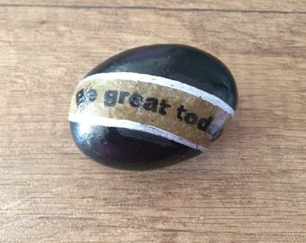 "Stone decorated with motivational phrase ""Be great today"""