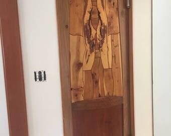 Naked woman door