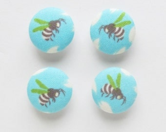 Bee Buttons 3/4 Inch | Four 19mm self shank buttons with brown and green bees on a turquoise background.