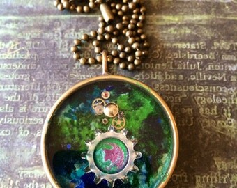 Green and blue pendant with planet