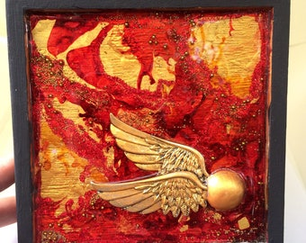 Red and gold golden snitch box