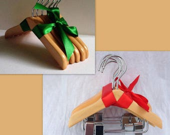 2 Bundles of 6 Wooden Doll Hangers, one bundle with clips and one without