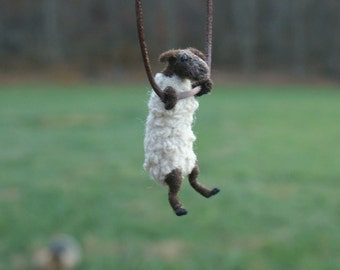 Tiny sheep sculpture / necklace - needle felted