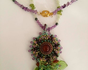 Beadwoven Carnelian Pendant, Floral Necklace, Bronze Super Duo Flower Blossom, Peridot Green Leaves - Embroidery by enchantedbeads on Etsy