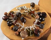 Brown gemstone chunky cha cha bracelet chock full of different gorgeous stones and it's adjustable too!