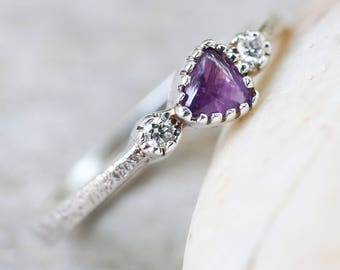 Triangle cabochon purple sapphire ring in texture sterling silver band and twin side set diamond gemstones