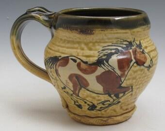 Mug with paint horses slip trailed  handmade pottery