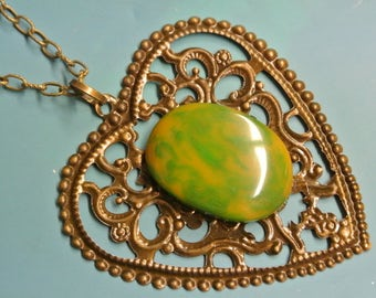Pendant necklace with genuine tested vintage 1950s flamy yellow/ grass green tested bakelite plastic cabochon and antiquecolor brass heart