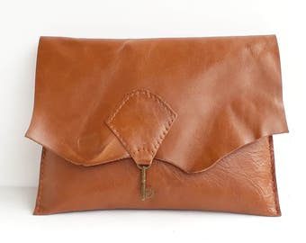Raw edge leather clutch purse with vintage key detail - tan
