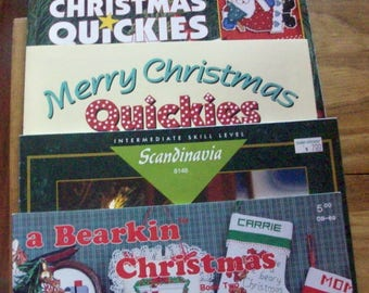 Four Christmas counted cross stitch booklets...One a  thick book of 250 quickie projects.