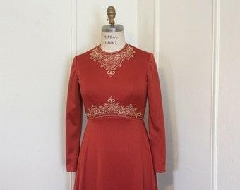 vintage 1970s Orange Rust Hostess Dress embellished with metallic gold bullion embroidery and rhinestones - size medium