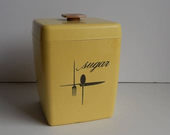 Plastic Mid Century Yellow Sugar Canister with Knife Fork and Spoon Design