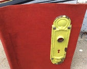 Playful large leather photo album by Binding Bee- includes photo corners, archival pages, and features an antique doorplate.