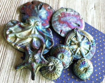 81. An Octopuses Garden Raku Wondrousstrange Urchin Seastar Sand Dollar Octopus Compass   Cabochons Blue Silver Rust  Magenta  Collection