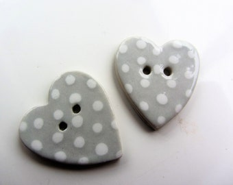 2 ceramic heart  shaped buttons  handmade spotted pattern