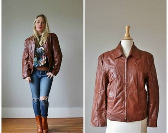 25% OFF SALE 1970s Wilsons Leather Jacket /// Women's Size md to lg /// Men's Size sm to md