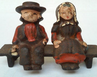 Vintage Amish Couple on Bench Cast Iron Figurines Man Woman Pennsylvania Dutch