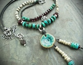 Teal Ceramic Medallion with Turquoise Garnets and Leather