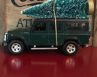 Land Rover Defender Carrying Christmas Tree Ornament