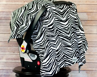 60% OFF - Car Seat Sun Shade in Zebra - Shield your baby from the sun, germs and the elements with a darling car seat canopy