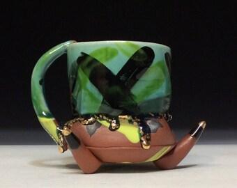 Pointy footed gold tipped black X mug modern funky wild coffee mug