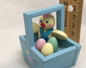 Little wooden easter basket with chick and eggs
