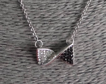 """Vintage silver tone 19"""" necklace with attached rhinestone bowtie pendant in great condition-appears unworn"""