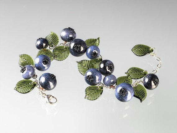 Glass Blueberry Charm Bracelet with 12 ripe blueberries in different sizes and tones of blue, on your choice of metals.  Art glass bracelet.