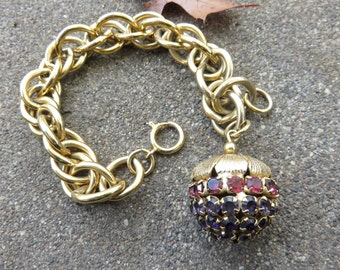 Vintage Chunky gold tone charm bracelet with Large Red Rhinestone Berry charm
