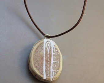 Embraced - Alaska Native Hand painted Caribou antler pendant