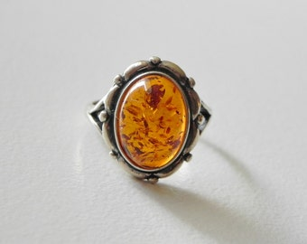 Sterling Silver Amber Ring. Oval Amber Cabochon. 925 Silver. Size 7.50 - 7.75.