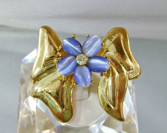 ON SALE Vintage Bow Brooch.  Blue Cat's Eye. Rhinestone.  Gold Bow.