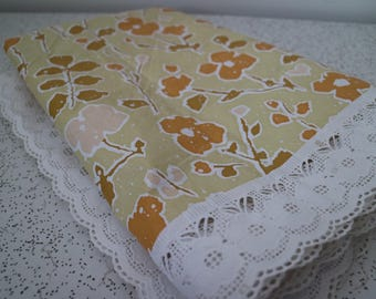 flowers in yellows...vintage vinyl tablecloth with lace edge