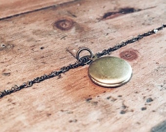 A cute and elegant round locket. Small, geometric, keepsake, her photo locket necklace