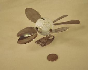 Spoon and fork Golf ball bird