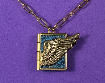 Winged Love Locket- aquamarine and gold, holding 14 ways to tell someone you love them, from English to American Sign Language.
