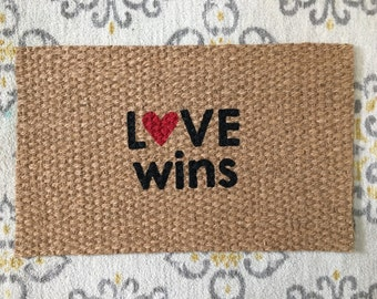Love Wins Doormat. Welcome mats with a positive message!