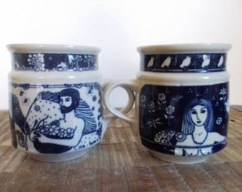 Pair of 1976 Blue Taylor and Ng Adam and Eve Garden of Eden Mugs