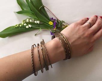 set of 11 bronze thin stacking bangles | 1970s boho metal bangles
