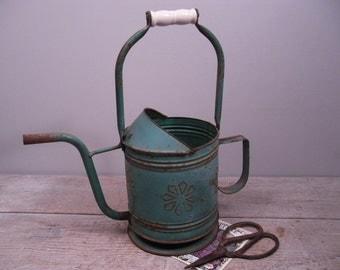 rustic metal watering can / green metal water can