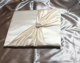 Ivory or white color wedding guest book with pen holder