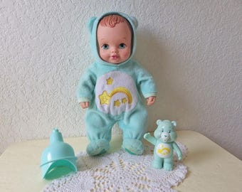 """Lauer Water Baby Doll dressed as Care Bear """"WISH"""" with Original Rattle and Funnel, 1990"""