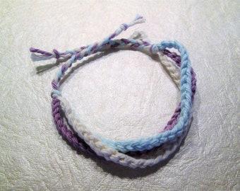 Friendship bracelet, cotton, crocheted, light blue, light purple and cream
