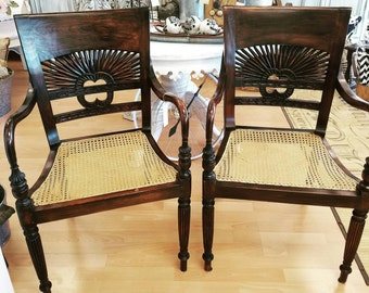 Pair of teak arm chairs with cane seats