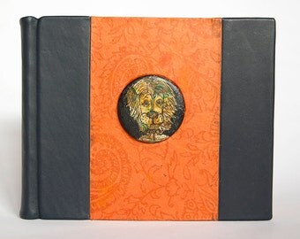 Hand-Bound Blank Notebook with Split Board Binding, Navy Blue Leather and Decorative Orange Paper with Lion Button (2017), Item No. 249