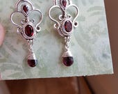 Reserved for Gaynor Handcrafted sterling silver piecework Bali style earrings with garnet gemstones and gaenet dangle drops. Final pmt