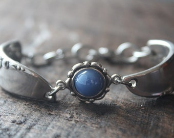 Brilliant Antique Spoon Bracelet with Blue Charm and Floral Accents