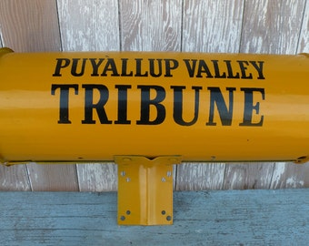 Vintage PUYALLUP Valley Tribune newspaper tube Black writing on old yellow paint