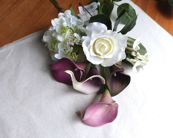 Reserved green orchid, creme white roses with picasso calla lily cascade bouquet